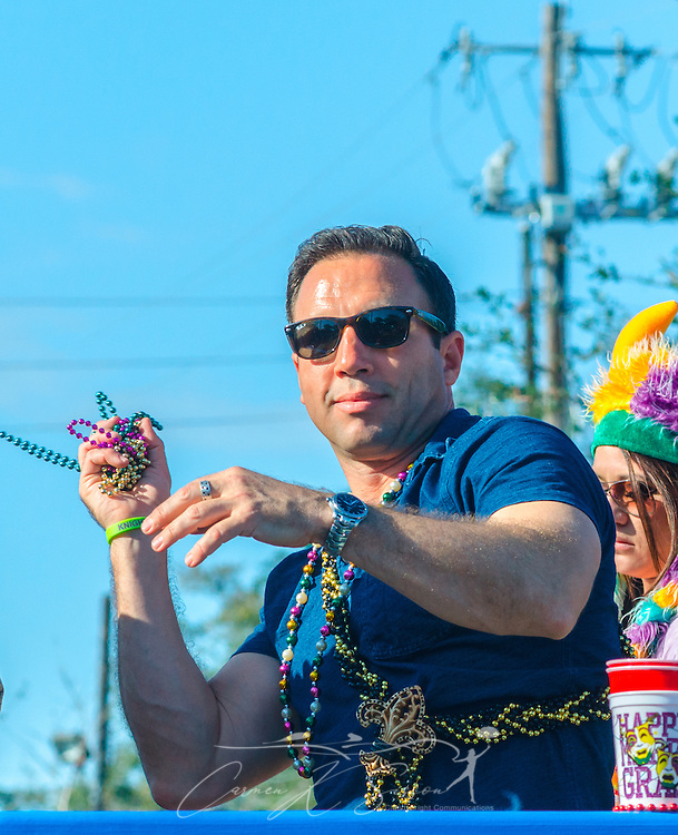 A reveler throws beads to the crowd as his float travels down Canal Street in downtown Mobile, Ala., during the Joe Cain Procession at Mardi Gras, March 2, 2014. French settlers held the first Mardi Gras in 1703, making Mobile's celebration the oldest Mardi Gras in the United States. (Photo by Carmen K. Sisson/Cloudybright)