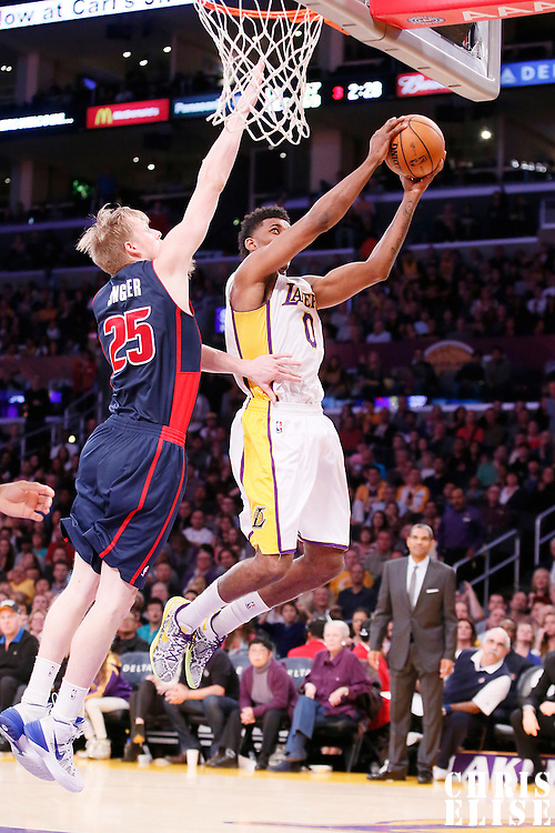 17 November 2013: Los Angeles Lakers small forward Nick Young (0) goes for the layup past Detroit Pistons small forward Kyle Singler (25) during the Los Angeles Lakers 114-99 victory over the Detroit Pistons at the Staples Center, Los Angeles, California, USA.