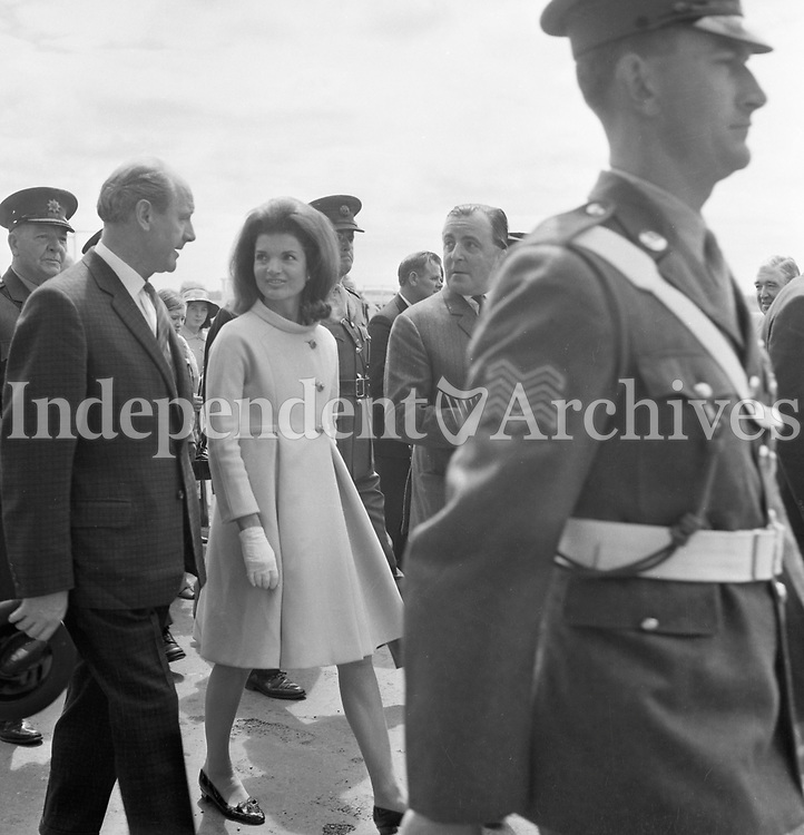 Jacqueline Kennedy's 1967 visit to Ireland.<br /> Mrs. Jackie Kennedy at The Curragh, 1st July 1967.<br /> An Taoiseach Mr. Jack Lynch T.D. walks with her.<br /> A caption on Monday 3rd July 1967 in The Irish Independent, P.7: 'Jacqueline Kennedy accompanied by the Taoiseach Mr. Lynch, on her arrival at the Curragh on Saturday to attend the Irish Sweeps Derby.'<br /> (Part of the Independent Ireland Newspapers/NLI Collection)