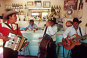 IXMIQUILPAN, HIDALGO, MEXICO: A band performs in a cantina in the town of Ixmiquilpan, state of Hidalgo, central Mexico. PHOTO © JACK KURTZ   alchohol      culture  economy