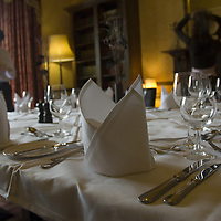 Table ready for formal dinner party in formal traditional dining room<br />