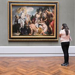 Woman looking painting Die Entfuhring der Europa by Jacob Jordaens at Gemaldegalerie museum, at Kulturforum in Berlin, Germany