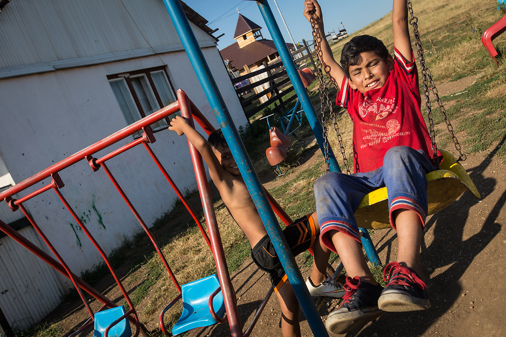 Roma boys play near temporary housing built on top of a hill near the Pata Rat garbage dump.  In 2010, 260 Roma were expelled from their municipal housing in Cluj-Napoca's central Costei street and relocated here.                                                              © Daniel Barreto Mezzano