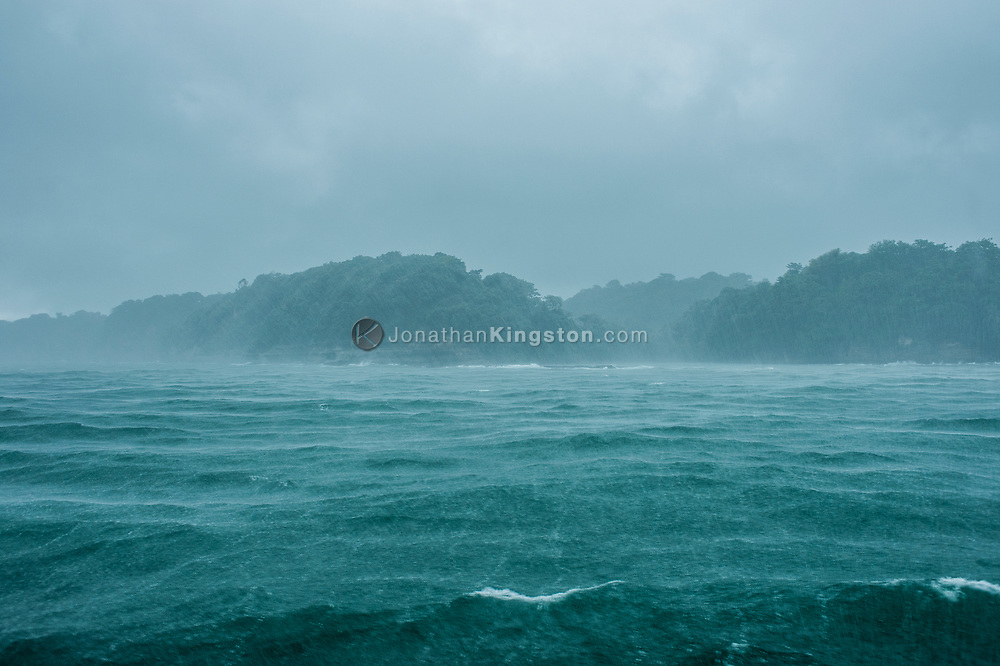Heavy wind and rains on the ocean looking toward land in Panama.