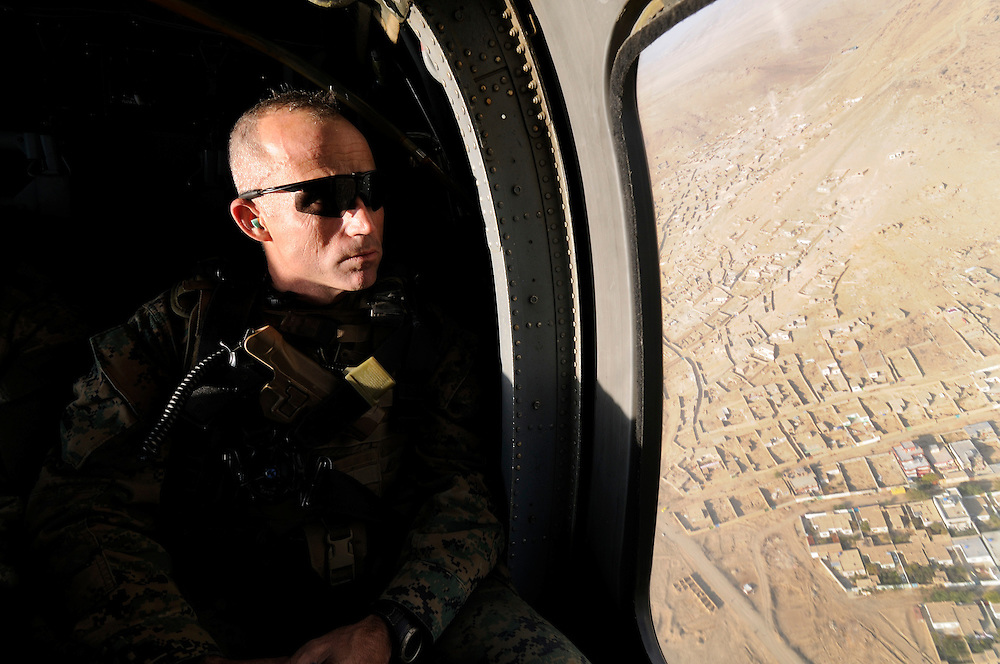 US Marine Colonel Jeff Haynes, Commanding Officer, 201st Regional Corps Advisory Command, looking down on Kabul from a Black Hawk helicopter while returning from a counterinsurgency meeting at Bagram Air Base.  He met with Generals from the Afghan, Pakistan and US militaries.