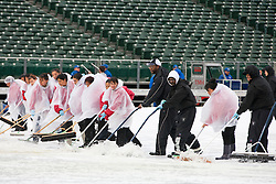 December 19, 2010; Oakland, CA, USA;  Groundskeepers clear water from a tarp covering the field before the game between the Oakland Raiders and the Denver Broncos at Oakland-Alameda County Coliseum.