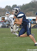 John Glenn's Antony Merchant (21) persues a Northmen ball carrier to the outside during the Bobcats playoff loss in Petoskey Saturday.