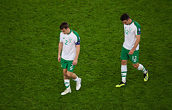 CARDIFF, WALES - Thursday, September 6, 2018: Republic of Ireland's captain Séamus Coleman and Enda Stevens look dejected after losing 4-1 to Wales during the UEFA Nations League Group Stage League B Group 4 match between Wales and Republic of Ireland at the Cardiff City Stadium. (Pic by Laura Malkin/Propaganda)