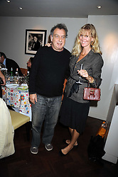 STEPHEN FREARS and CARINA COOPER at a dinner hosted by Kathryn Ireland at Lucio, 257-259 Fulham Road, London SW3 on 24th September 2008.