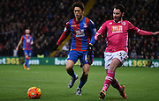 Chung Yong Lee closes down his man during the Barclays Premier League match between Crystal Palace and Bournemouth at Selhurst Park, London, England on 2 February 2016. Photo by Michael Hulf.