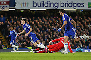 Oscar of Chelsea is fouled by Lucas Leiva of Liverpool during the Capital One Cup Semi Final 2nd Leg match between Chelsea and Liverpool at Stamford Bridge, London, England on 27 January 2015. Photo by David Horn.