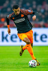 Cody Gakpo #19 of PSV Eindhoven in action during the match between Ajax and PSV at Johan Cruyff Arena on February 02, 2020 in Amsterdam, Netherlands