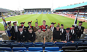 Veterans and current soldiers from the Black Watch pictures with Dundee FC player Calvin Colquhoun at Dens Park as the club launch their Battle of Loos Centenary kit<br /> <br /> Dundee are offering free tickets for the Ross County match to current and former members of the Armed Forces.<br /> <br /> &copy; David Young<br /> davidyoungphoto@gmail.com<br /> www.davidyoungphoto.co.uk