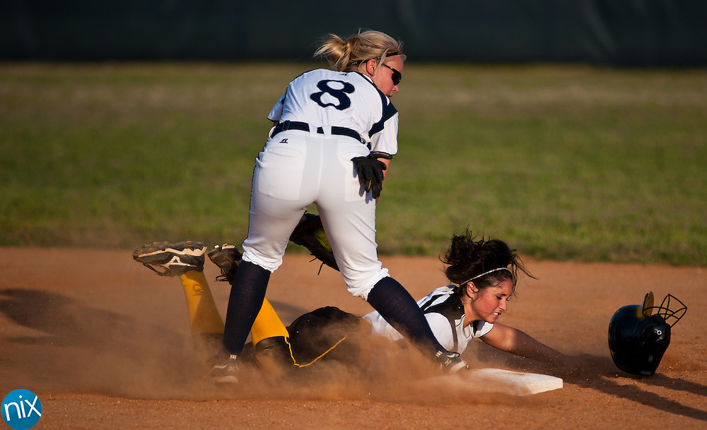 Hickory Ridge's Lauren Hill tags out Concord's Jenna Bruhozel at second during South Piedmont Conference softball action Tuesday afternoon in Harrisburg. Hickory Ridge won the game 7-1.  (Photo by James Nix)