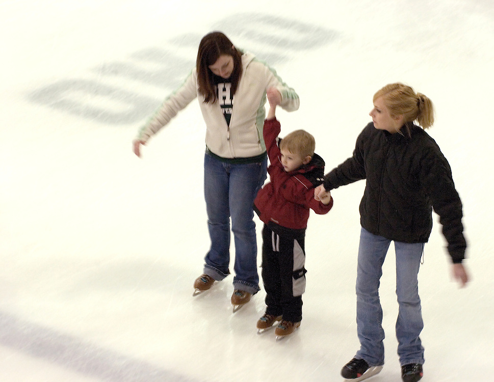 Talour Avdek (student) and Kristen Krempasky (student) help Jonathan Krepasky skate at Bird Arena during Sibs weekend