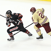 Torin Snyderman #17 of the Northeastern Huskies and Scott Savage #28 of the Boston College Eagles on the ice during The Beanpot Championship Game at TD Garden on February 10, 2014 in Boston, Massachusetts. (Photo by Elan Kawesch)