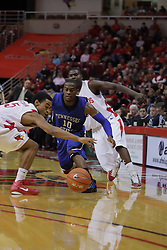 17 November 2010:  Wil Peters gives up the ball to Anthony Cousins during an NCAA basketball game between the Tennessee State Tigers and the Illinois State Redbirds at Redbird Arena in Normal Illinois.
