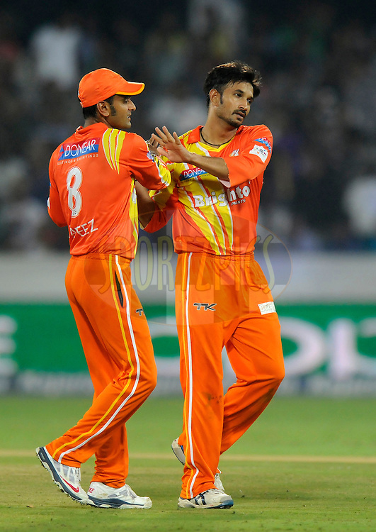 Aizaz Cheema of Lahore Lions celebrates the wicket of Yusuf Pathan of Kolkata Knight Riders during match 7 of the Oppo Champions League Twenty20 between the Kolkata Knight Riders and the Lahore Lions held at the Rajiv Gandhi Cricket Stadium, Hyderabad, India on the 21st September 2014<br /> <br /> Photo by:  Pal Pillai / Sportzpics/ CLT20<br /> <br /> <br /> Image use is subject to the terms and conditions as laid out by the BCCI/ CLT20.  The terms and conditions can be downloaded here:<br /> <br /> http://sportzpics.photoshelter.com/gallery/CLT20-Image-Terms-and-Conditions-2014/G0000IfNJn535VPU/C0000QhhKadWcjYs