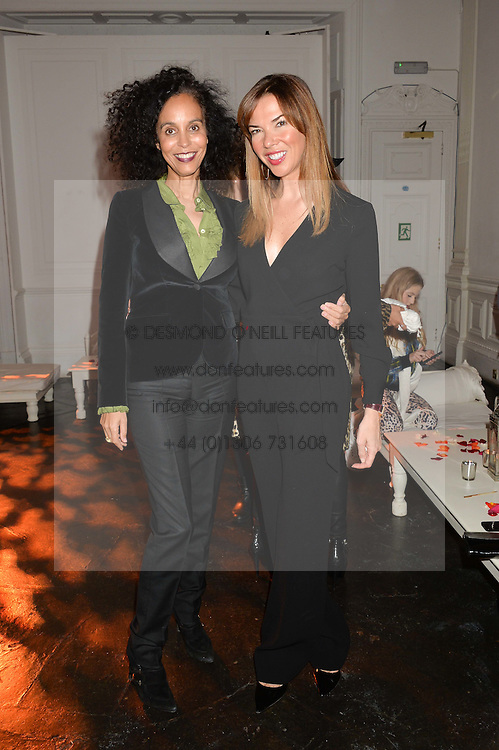 Left to right, JEANETTE CALLIVA and HEATHER KERZNER at White by Agadir hosted by the Moroccan National Tourist Office to celebrate the White City in Morocco in the presence of H.H.Princess Lalla Joumala, Ambassador of HM The King of Morocco held at Il Bottaccio, 9 Grosvenor Place, London on 4th November 2014.