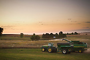 """As the sun settles below the Iowa horizon, while many people are grabbing a seat around the TV, a small subset of individuals begins their tiresome, yet necessary job of harvesting the crops our society has come to depend on. This is the story of one of these """"midnight harvesters."""""""