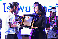"""CHIANG RAI, THAILAND - DECEMBER 25: Aritwara """"Thoon Bodyslam"""" Kongmalai receiving the Guiness Record for the first male to run from the southern-most-point Betong, Yala to northern-most-point Mae Sai, Chiang Rai during the Kao Konla Kao, Chiang Rai, Thailand on December 25, 2017.<br /> .<br /> .<br /> .<br /> (Photo by: Naratip Golf Srisupab/SEALs Sports Images)<br /> .<br /> Any image use must include a mandatory credit line adjacent to the content which should read: Naratip Golf Srisupab/SEALs Sports Images"""