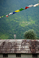 Prayer flays flying above a guest house, Annapurna Sanctuary, Nepal