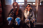 Two men drink chai in Chandni Chowk, Old Delhi, India