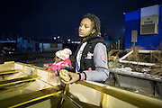 Diamond Campbell, accompanied by Nagele Johnson, is explaining how she made the boat to her mother, Rocking the Boat, Hunts Point, Dec.13, by Qingqing Chen