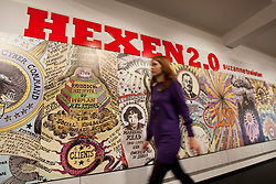 © licensed to London News Pictures. London, UK 06/03/2012. A woman walks past Suzanne Treister's Hexen 2.0 exhibition. Treister applies new subjects and suggestions to the tarot format in her new exhibition at Science Museum, London. Photo credit: Tolga Akmen/LNP