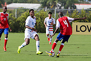 Team USA defender Justin Reynolds (16) pressures and looks to take the ball from Team Haiti defender Alexandre Michelson (4) during a CONCACAF boys under-15 championship soccer game, Sunday, Aug. 4, 2019, in Bradenton, Fla. The USA defeated Haiti 2-0 (Kim Hukari/Image of Sport)