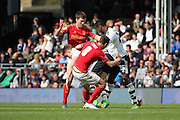 Fulham striker, Matt Smith (09) unable to find a way through during the Sky Bet Championship match between Fulham and Nottingham Forest at Craven Cottage, London, England on 23 April 2016. Photo by Matthew Redman.