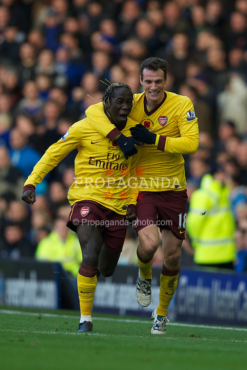 LIVERPOOL, ENGLAND - Sunday, November 14, 2010: Arsenal's Bacary Sagna celebrates scoring the opening goal against Everton with team-mate Sebastian Squillaci during the Premiership match at Goodison Park. (Photo by: David Rawcliffe/Propaganda)