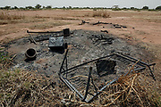 The remains of a hut after it was burned to the ground by Janjaweed malitia, Barka, South Darfur,Sudan Monday 25 October 2004.<br /> <br /> 33 people were killed and the village of Barka destroyed in September 2004 when Janjaweed malitia attacked the village. The survivors fled to an IDP (Internally displaced peoples) camp 40 kilometers away in SLA controlled Muhajiriyah.<br /> <br /> EPA PHOTO/NIC BOTHMA
