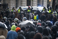 © Licensed to London News Pictures. 06/06/2020. London, UK. Police on horseback move in on protesters as they gather outside Downing Street in  Westminster, central London to take part in a Black Lives Matter demonstration over the killing of African American George Floyd. The death of George Floyd, who died after being restrained by a police officer In Minneapolis, Minnesota, caused widespread rioting and looting across the USA. Photo credit: Ben Cawthra/LNP