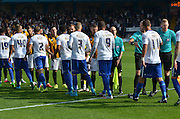 the teams greet each oither during the Sky Bet League 1 match between Bury and Port Vale at Gigg Lane, Bury, England on 19 September 2015. Photo by Mark Pollitt.