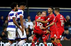 Tom Smith of Swindon Town celebrates with teammates after scoring an equalising - Mandatory by-line: Robbie Stephenson/JMP - 10/08/2016 - FOOTBALL - Loftus Road - London, England - Queens Park Rangers v Swindon Town - EFL League Cup