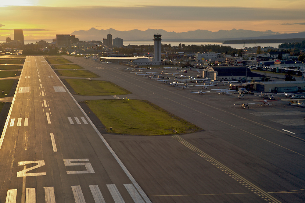 Landing a small plane at Anchorage's Merrill feild at sunset reminds you of the important connection between the single engine bush plane and the tousands of square miles of wilderness just a few minuet's flight from Anchorage.