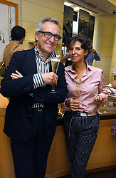 STEPHEN & FLO BAYLEY at a party hosted by Links at their store in Sloane Square, London to celebrate the forthcoming Glorious Goodwood Racing festival held on 26th July 2006.<br /><br />NON EXCLUSIVE - WORLD RIGHTS