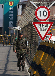 South Korean soldiers stand guard at the Unification Bridge near the Customs, Immigration and Quarantine (CIQ) office in Paju, Gyeonggi province of South Korea, April 10, 2013. South Korea is seeing the warning by the Democratic People s Republic of Korea (DPRK) to foreigners in Seoul to consider evacuation as psychological warfare, the presidential office said Tuesday, April 10, 2013. Photo by Imago / i-Images...UK ONLY.