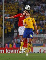 Photo: Glyn Thomas.<br />Sweden v England. FIFA World Cup 2006. 20/06/2006.<br /> England's Owen Hargreaves (L) and Sweden's Henrik Larsson.