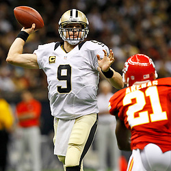 September 23, 2012; New Orleans, LA, USA; New Orleans Saints quarterback Drew Brees (9) is pressured by Kansas City Chiefs cornerback Javier Arenas (21) during the second quarter of a game at the Mercedes-Benz Superdome. Mandatory Credit: Derick E. Hingle-US PRESSWIRE