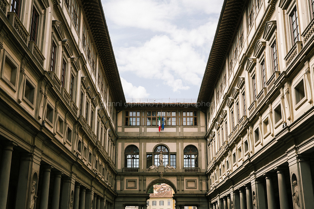 FLORENCE, ITALY - 4 JUNE 2018: A view of the Uffizi gallery in Florence, Italy, on June 4th 2018.<br /> <br /> As of Monday June 4th 2018, Room 41 or the &ldquo;Raphael and Michelangelo room&rdquo; of the Uffizi is part of the rearrangement of the museum's collection that has<br /> been defining Uffizi Director Eike Schmidt&rsquo;s grander vision for the Florentine museum.<br /> Next month, the museum&rsquo;s Leonardo three paintings will be installed in a<br /> nearby room. Together, these artists capture &ldquo;a magic moment in the<br /> first decade of the 16th century when Florence was the cultural and<br /> artistic center of the world,&rdquo; Mr. Schmidt said. Room 41 hosts, among other paintings, the dual portraits of Agnolo Doni and his wife Maddalena Strozzi painted by Raphael round 1504-1505, and the &ldquo;Holy Family&rdquo;, that Michelangelo painted for the Doni couple a year later, known as the<br /> Doni Tondo.