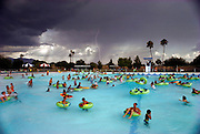 Breakers Water Park in Tucson, Arizona. A lightning detector is used to monitor the proximity of lightning, giving the lifeguards time to warn the swimmers when to get out of the water. 1993.
