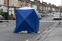 © Licensed to London News Pictures. 22/03/2017. LONDON, UK.  A police forensic tent in Bedford Road. A man has died after being shot in Ilford, east London. Police were called to reports of a shooting at the junction of Ilford Lane and Bedford Road in Ilford at 22:10 last night. Emergency services found the victim, a man unconscious with a gunshot wound and he died shortly after.  Photo credit: Vickie Flores/LNP