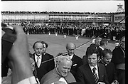 Pope John-Paul II visits Ireland..1979..29.09.1979..09.29.1979..29th September 1979..Today marked the historic arrival of Pope John-Paul II to Ireland. He is here on a three day visit to the country with a packed itinerary. He will celebrate mass today at a specially built altar in the Phoenix Park in Dublin. From Dublin he will travel to Drogheda by cavalcade. On the 30th he will host a youth rally in Galway and on the 1st Oct he will host a mass in Limerick prior to his departure from Shannon Airport to the U.S..As the Pope continues to speak with some children An Taoiseach, Jack Lynch and the Minister for Foreign Affairs,Michael O'Kennedy are pictured at his back.
