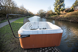 © Licensed to London News Pictures. 29/12/2015. Elland UK. A hot tub has been left stranded on the banks of the Calder & Hebble Navigation at Park Nook Lock in Elland after recent flooding.  Photo credit: Andrew McCaren/LNP