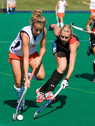 Virginia Cavaliers midfielder Haley Carpenter (3) is challenged by Maryland Terrapins Forward Katie O'Donnell (16).  The #1 ranked Maryland Terrapins defeated the #10 ranked Virginia Cavaliers 4-3 in overtime in NCAA Field Hockey at the Turf Field on the Grounds of the University of Virginia in Charlottesville, VA on October 4, 2008.
