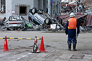 An Iwate government official surveys the effects of the tsunami that struck north east Japan on March 11th Kamaishi,, Iwate, Japan. March 17th 2011