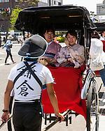 Two ladies in Kimonos on a Rickshaw ride in  Kamakura Japan
