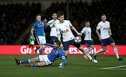 Rochdale's Ian Henderson (left) goes to ground under pressure from Tottenham Hotspur's Juan Foyth during the Emirates FA Cup, Fifth Round match at the Crown Oil Arena, Rochdale.